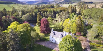 Spring sunshine over Cray House and the foot-hills of Glenshee